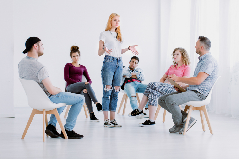 woman talking in group therapy for addiction