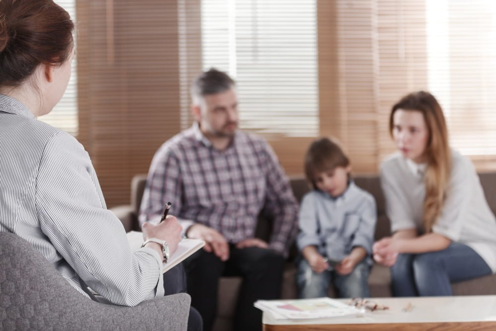 family talking during family therapy session